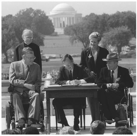 President George Bush signed the Americans with Disabilities Act into law on July 26, 1990.