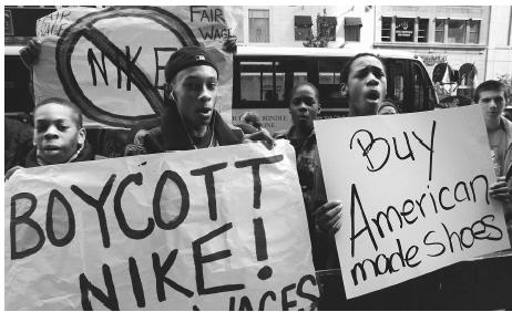 Protestors picket Nike's manufacturing practices of outsourcing.