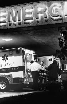 An ambulance crew unloads a patient at the emergency room entrance at Beth Israel Hospital, New York City. In 1995, there were 531,800 drug-related visits to U.S. hospital emergency rooms; more than half were due to drug overdoses. (EdEckstein/CORBIS)