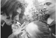 Teenagers share a joint during an annual marijuana legalization rally in New York City's Washington Square Park, May 4, 1996. (AP Photo/Bebeto Matthews)