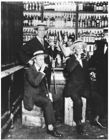 Patrons of a speakeasy enjoy a drink illegal under the Volstead Act. Undated photograph. (© Bettmann/CORBIS)