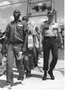 "Participants in the Sumter County Correctional Institution ""boot camp"" program arrive at their barracks in Bushnell, Florida, July 9, 1989. (© Bettmann/CORBIS)"