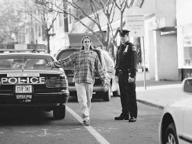If police suspect someone is driving drunk, they give the driver a sobriety test. Here, a youth is instructed to walk a straight line. If he cannot do so without stumbling, chances are that he is intoxicated. Richard Hutchings/Corbis.