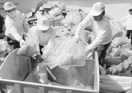 Many countries destroy illegal drugs seized in police raids. Here, Thailand officials load packs of amphetamines onto a cart to be burned in an incinerator in December 2004. The amphetamines were among 3.5 tons of drugs taken to the incinerator