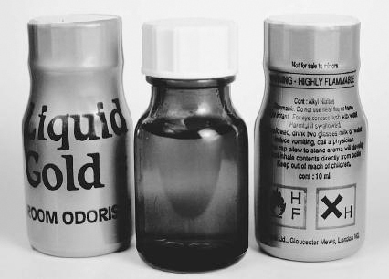 Amyl nitrite (center) and Liquid Gold are nicknamed poppers. They are stimulant drugs that are often abused at all-night dance parties called raves. Science Photo Library.