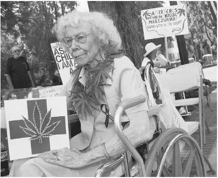A medical marijuana patient joins other protesters in California outside the states capitol in 2002. The group is protesting raids and arrests that have occurred in state-approved and licensed medical marijuana dispensaries. Kim Kulish/Corbis.