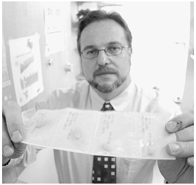 Dr. Warren Bickel displays a sample of buprenorphine, a painkiller used to treat opiate addiction. Buprenorphine works the same way as methadone, but is not believed to pose the risk of an overdose. Photo by Jordan Silverman/Getty Images.