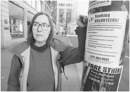Ann Livingston, the director of the Vancouver Area Network of Drug Users, leans against a poster seeking volunteers to participate in an opiate study in 2005. The controversial program is designed to help hard-to-treat heroin addicts in Vancouv