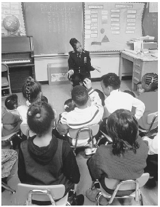 Early drug education is one way to help students learn about the dangers of certain drugs and ultimately avoid the pain of addiction. Here, a police officer talks with elementary school children in their classroom. James Marshall/Corbis.