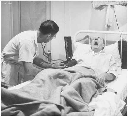 A man addicted to morphine is shown in a hospital setting in the late 1940s. He yawns and gasps for air as he experiences severe withdrawal from the drug. Photo by Ralph Morse/Time Life Pictures/Getty Images.