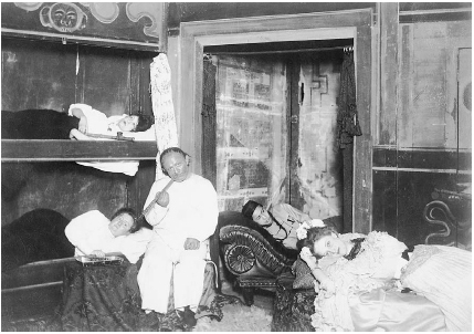 Customers of an opium den in New York City are shown lying on bunks and beds as they consume the drug through pipes in the early 1900s. Many opium dens operated in the Chinatown section of large cities in the United States. In fact, in 1896, mo