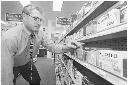 In large pharmacies, hundreds of over-the-counter medications line the shelves. How do people know which ones are right for them? When in doubt, people can check with their doctors or pharmacists. AP/Wide World Photos.