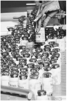 A worker is shown checking new bottles of the over-the counter painkiller Tylenol in 1982. The bottles feature tamper-resistance packing, which was new at that time. The safety seals were added after seven people in the Chicago area were killed