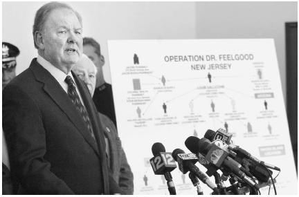 Prosecutor Theodore Romankow informs reporters in New Jersey in November 2004 about the bust of a major drug ring that dealt OxyContin. As part of Operation Dr. Feelgood, authorities nabbed suspected drug dealers and suppliers in several states