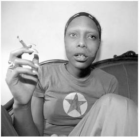 A young woman is shown smoking a cigarette loaded with PCP. Such cigarettes are nicknamed dips. Scott Houston/Corbis.