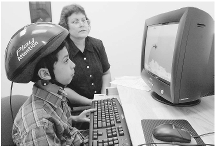 An eight-year-old boy learns concentration skills as he plays a computer game. In the game, he tries to move images on the screen using only his mind. Such therapies are being developed as alternatives to drugs like Ritalin. AP/Wide World Photo