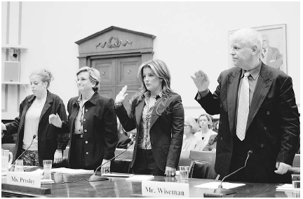Singer Lisa Marie Presley (second from right), national spokesperson for the Citizens Commission on Human Rights (CCHR), addresses a congressional committee about the dangers of drugs like Ritalin and urges parents to consider alternatives to s