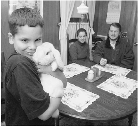 A young boy with ADHD is shown with his parents at their home in Massachusetts. His mother filed a civil rights complaint against his school claiming that his teachers were pressuring her to keep her son on Ritalin. AP/Wide World Photos.