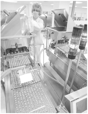 A pharmaceutical worker is shown operating a drug-packaging machine. Rohypnol is made and prescribed legally in Europe and Latin America, but is illegal in the United States. Smugglers sell the drug on U.S streets and in clubs, often in its ori
