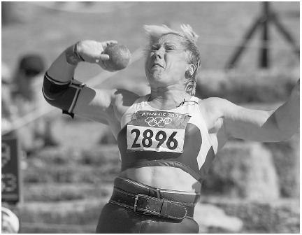 Irina Korzhanenko of Russia won the womens shot put competition at the Olympic Games in Greece in 2004. However, she was stripped of her gold medal after testing positive for steroids. George Tiedemann/New Sport/Corbis.