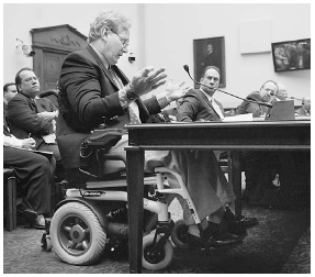 Robert Hazelton testifies before the House Committee on the Judiciary about the Anabolic Steroid Control Act of 2004. A former boxer and steroid user, Hazelton explains how he lost his legs because of steroid use. AP/WideWorld Photos.