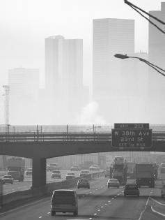 "Denver's ""brown cloud,"" the haze of air pollution that hangs over the city, is kept in place by atmospheric inversion layers. © Ted Spiegel/Corbis. Reproduced by permission."