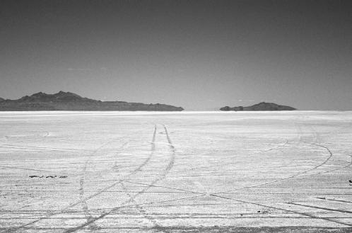 The Bonneville Salt Flats in Utah were at one time covered by a sea of salt water. Evaporation removed the water, leaving the salt behind. © Buddy Mays/Corbis. Reproduced by permission.