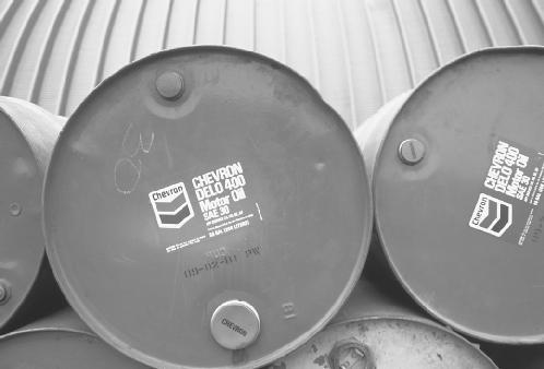 Barrels of motor oil are one product of the distillation, or cracking, of crude oil. © Vince Streano/Corbis. Reproduced by permission.