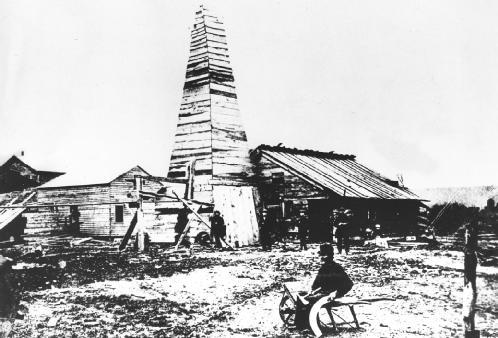 The first oil well, drilled by Colonel Edwin Drake near Titusville, Pennsylvania. AP/Wide World. Reproduced by permission.