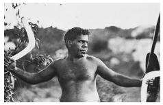 An Australian Aborigine prepares to throw a boomerang while hunting in the Outback. Photo dated 1930. © BETTMANN/CORBIS.