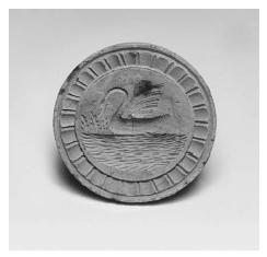 "Scottish shortbread stamp with swan motif circa 1870. These stamps, or ""prints"" as they were called, were carved by craftsmen who traveled from village to village selling them during the summer months. ROUGHWOOD COLLECTION. PHOTO CHEW & COMPANY."
