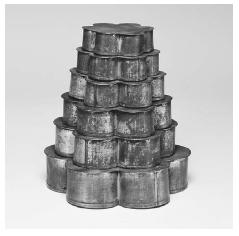 Stacked tube pans for gâteau breton. Made by E. Dehillerin, Paris, ca. 1912. White metal. ROUGHWOOD COLLECTION. PHOTO CHEW & COMPANY.