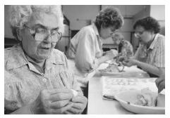 Like the United States, Canada is home to many ethnic communities. These Greek Canadians are preparing traditional Easter pastries in Vancouver, British Columbia. © ANNIE GRIFFITHS BELT/CORBIS.