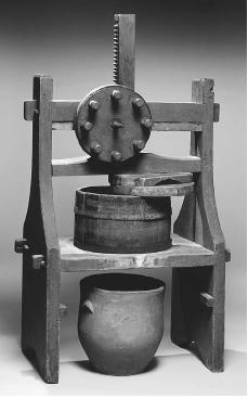 Red-painted cheese press, Connecticut, ca. 1835. Tulip poplar and oak. The press creates a wheel of cheese inside the tub, while excess whey drips from the drain into an earthenware pot. ROUGHWOOD COLLECTION. PHOTO CHEW & COMPANY.