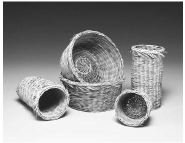 Traditional baskets for straining cheese curds. Cyprus, 20th century. Myrtle twigs. The use of myrtle for cheese strainers dates to classical antiquity. ROUGHWOOD COLLECTION. PHOTO CHEW & COMPANY.