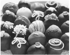 Chocolate truffles are considered among the most luxurious of all chocolate confections. © C/B PRODUCTIONS/CORBIS.