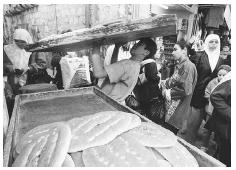 Bakers in the Old City of Jerusalem are selling holiday bread for Ramadan. PHOTO COURTESY OF AP/WORLD WIDE PHOTOS.