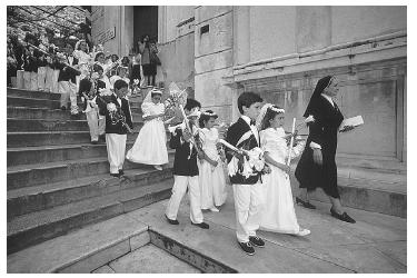 First Communion procession in the Duomo Square of Positano, Italy. The communion service is followed by large family meals. © JONATHAN BLAIR/CORBIS.