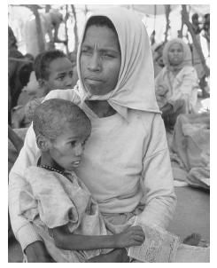 Mother with malnourished child in famine-stricken Somalia. COURTESY PHOTO RESEARCHERS, INC.