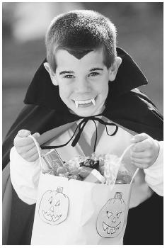 The most recent development in the evolution of the American Halloween is the costumed trick-or-treater. It began in the 1920s and has become a national custom, especially for children. © ED BOCK/CORBIS.