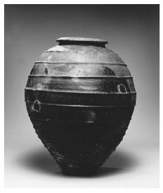 Traditional olive oil storage jar. Spain, seventeenth century. Gray earthenware. The design is based on the ancient Roman dolium. The exterior of the jar was sealed with pitch (still extant), then sunken into the floor of the cellar. ROUGHWOOD COLLECTION. PHOTO CHEW & COMPANY.