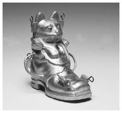 Puss-in-boots ice cream mold. New York, circa 1881. Pewter alloy (cleaned). Like period gingerbread molds, themes for ice cream molds were derived from popular culture. In this case, the mold design is based on an 1881 Christmas trade card (next page). ROUGHWOOD COLLECTION. PHOTO CHEW & COMPANY.