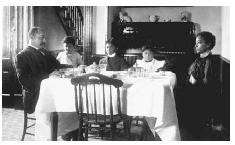 An upper-class African American family eating dinner in their home during the early 1900s. COURTESY OF THE LIBRARY OF CONGRESS.
