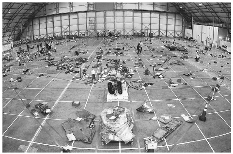 A view of the floor of the Kennedy Space Center RLV Hangar showing a grid with outline of an orbiter and much of the space shuttle Columbia debris collected as of March 11, 2003, by the Columbia Reconstruction Project Team. Reconstruction of th