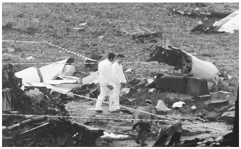 Forensic experts inspect some of the wreckage on July 26, 2000, after the crash of an Air France Concorde which ditched in a field outside Paris shortly after takeoff, killing its 109 passengers and crew. REUTERS/CORBIS.