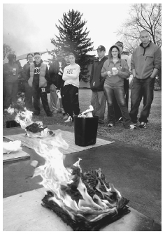 Students at Centenary College (Hackettstown, New Jersey) observe burning patterns in several staged fires during an arson investigation course, taught by former Somerset County arson investigator Professor Norman Cetuk, March 4, 2004. AP/WIDE W