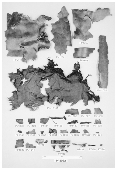 A forensic explosives laboratory photograph shows recovered fragments of a suitcase containing a bomb that exploded aboard the Pan Am airliner above Lockerbie in December, 1988.  REUTERS/CORBIS