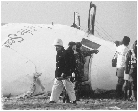 Rescue workers and crash investigators search the area around the cockpit of Pan Am flight 103 that crashed east of Lockerbie, Scotland in 1988, killing 270 people. Investigators found the aircraft was downed by a Libyan planted bomb exploding