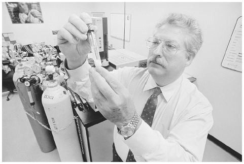 After contaminated cattle feed was traced through the food chain in the Midwest in 1986, a scientist prepares to test a tube of mothers milk by gas chromatography to determine if the amount of Heptachlor in the milk is sufficient to harm babies