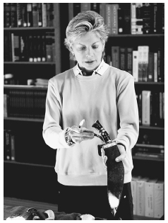 Patricia Cornwell holds a knife that was available in England when Jack the Ripper went on his killing spree. AP/WIDE WORLD PHOTOS. REPRODUCED BY PERMISSION.